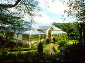 The Falls Rainforest Cottages - Whitsundays Tourism
